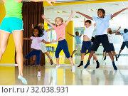 Купить «sportive children with teacher jumping together», фото № 32038931, снято 7 июля 2020 г. (c) Яков Филимонов / Фотобанк Лори