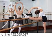 Купить «Young efficient dancer exercising in ballroom», фото № 32039027, снято 26 апреля 2019 г. (c) Яков Филимонов / Фотобанк Лори