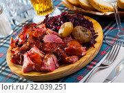 Купить «Sliced pork shank with braised cabbage», фото № 32039251, снято 15 октября 2019 г. (c) Яков Филимонов / Фотобанк Лори