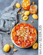 Купить «Sliced caramelized tarte tatin pie with apricots», фото № 32039335, снято 10 июля 2019 г. (c) Марина Сапрунова / Фотобанк Лори