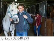 Купить «Man in casual clothes who works at stable», фото № 32040279, снято 26 ноября 2018 г. (c) Яков Филимонов / Фотобанк Лори