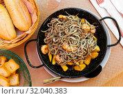 Купить «Plate of tasty fried baby eels and prawns with potatoes», фото № 32040383, снято 15 июля 2019 г. (c) Яков Филимонов / Фотобанк Лори