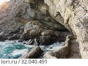 Купить «Грот Голицына (Эстрадный, Шаляпина) - крупный естественный грот, выбитый морскими волнами в горе Коба-Кая (Пещерная) неподалеку от поселка Новый Свет в Крыму», фото № 32040491, снято 9 марта 2019 г. (c) Наталья Гармашева / Фотобанк Лори