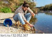 Купить «Bearded adult man posing with fish near river in summertime», фото № 32052367, снято 15 марта 2019 г. (c) Яков Филимонов / Фотобанк Лори