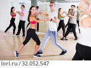 Купить «Young dancing pair dance tango together», фото № 32052547, снято 9 октября 2017 г. (c) Яков Филимонов / Фотобанк Лори