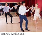 Happy group people dancing lindy hop in pairs. Стоковое фото, фотограф Яков Филимонов / Фотобанк Лори