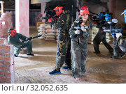 Купить «man and woman in red masks are preparing to attack», фото № 32052635, снято 10 июля 2017 г. (c) Яков Филимонов / Фотобанк Лори
