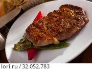 Купить «Beef steak with braised vegetables», фото № 32052783, снято 15 октября 2019 г. (c) Яков Филимонов / Фотобанк Лори