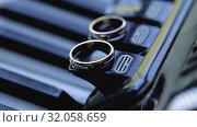 Gold Wedding Rings macro closeup on a musical instrument diamon Jewellery. Стоковое видео, видеограф Aleksejs Bergmanis / Фотобанк Лори
