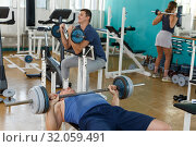 Group of people doing exercises with barbell. Стоковое фото, фотограф Яков Филимонов / Фотобанк Лори