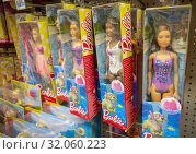 An assortment of various Mattel Barbie Dolls in a KMart store in New York on Friday, March 8, 2019. Barbie is celebrating its 60th anniversary and isn... Редакционное фото, фотограф Richard Levine / age Fotostock / Фотобанк Лори