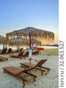 Купить «Thatched umbrellas, Chalkidiki, Greece», фото № 32063527, снято 13 июня 2019 г. (c) Boris Breytman / Фотобанк Лори