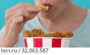 Купить «Girl eating chicken wings», видеоролик № 32063587, снято 22 августа 2019 г. (c) Ekaterina Demidova / Фотобанк Лори