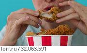 Купить «Girl eating chicken wings», видеоролик № 32063591, снято 22 августа 2019 г. (c) Ekaterina Demidova / Фотобанк Лори