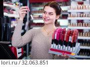 Teenage girl is searching for reliable lipstick. Стоковое фото, фотограф Яков Филимонов / Фотобанк Лори