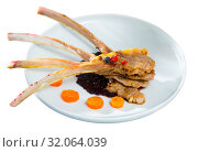 Купить «Tasty lamb ribs baked and served with spicy sauce and carrots at plate», фото № 32064039, снято 19 сентября 2019 г. (c) Яков Филимонов / Фотобанк Лори