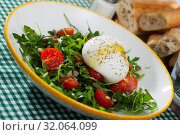 Купить «Image of salad with burrata italian cheese, arugula and cherry tomatoes», фото № 32064099, снято 21 сентября 2019 г. (c) Яков Филимонов / Фотобанк Лори
