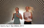 Купить «women or female friends with earphones running», видеоролик № 32064311, снято 4 августа 2019 г. (c) Syda Productions / Фотобанк Лори