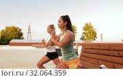 Купить «women training and doing single leg squats», видеоролик № 32064359, снято 4 августа 2019 г. (c) Syda Productions / Фотобанк Лори