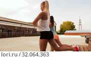Купить «women training and doing single leg squats», видеоролик № 32064363, снято 4 августа 2019 г. (c) Syda Productions / Фотобанк Лори