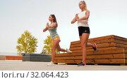 Купить «women training and doing single leg squats», видеоролик № 32064423, снято 4 августа 2019 г. (c) Syda Productions / Фотобанк Лори