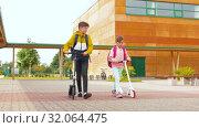 Купить «happy school children with backpacks and scooters», видеоролик № 32064475, снято 20 августа 2019 г. (c) Syda Productions / Фотобанк Лори
