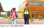 Купить «children with backpacks going to school», видеоролик № 32064491, снято 20 августа 2019 г. (c) Syda Productions / Фотобанк Лори