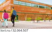 Купить «children with backpacks going to school», видеоролик № 32064507, снято 20 августа 2019 г. (c) Syda Productions / Фотобанк Лори