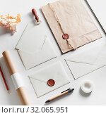 Купить «Vintage still life with postal accessories. Blank stationery and envelopes on paper background. Responsive design mockup.», фото № 32065951, снято 31 января 2020 г. (c) easy Fotostock / Фотобанк Лори