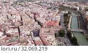 Купить «Aerial view of Murcia cityscape with a segura river and apartment buildings, Spain», видеоролик № 32069219, снято 17 апреля 2019 г. (c) Яков Филимонов / Фотобанк Лори