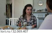 Купить «Smiling young female friends gossiping on sofa in home interior», видеоролик № 32069407, снято 27 мая 2019 г. (c) Яков Филимонов / Фотобанк Лори