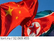 Купить «Государственный флаг Китайской Народной Республики и Корейской Народно-Демократической Республики развивается на ветру», фото № 32069455, снято 23 августа 2019 г. (c) Николай Винокуров / Фотобанк Лори