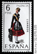 Palencia, Castile and Leon, woman in traditional fashioned regional costume, postage stamp, Spain, 1970. (2011 год). Редакционное фото, фотограф Ivan Vdovin / age Fotostock / Фотобанк Лори