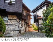 Купить «Typical residential architecture and narrow cobblestone street in the old town of Nessebar, Bulgaria», фото № 32073407, снято 26 июня 2019 г. (c) Юлия Бабкина / Фотобанк Лори