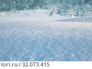 Купить «Natural winter background. Snowdrift of snow sparkling in the sun against backdrop of winter forest», фото № 32073415, снято 6 марта 2019 г. (c) Юлия Бабкина / Фотобанк Лори
