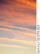 Купить «Небесный закатный пейзаж. Blue dramatic sunset sky background - picturesque colorful clouds lit by sunlight. Vast sky landscape panoramic scene in soft pastel tones, sunset view», фото № 32074423, снято 4 ноября 2018 г. (c) Зезелина Марина / Фотобанк Лори