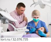 Купить «Girl visiting dentistry with father», фото № 32076735, снято 1 марта 2018 г. (c) Яков Филимонов / Фотобанк Лори