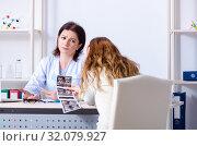 Купить «Young pregnant woman visiting experienced doctor gynecologist», фото № 32079927, снято 11 марта 2019 г. (c) Elnur / Фотобанк Лори