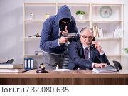 Купить «Young mobster threatening old judge», фото № 32080635, снято 23 апреля 2019 г. (c) Elnur / Фотобанк Лори