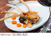 Купить «Baked lamb ribs with spicy sauce and carrots served at plate», фото № 32082423, снято 21 октября 2019 г. (c) Яков Филимонов / Фотобанк Лори