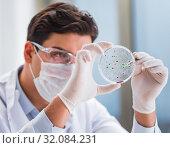 Купить «Male doctor working in the lab on virus vaccine», фото № 32084231, снято 27 января 2017 г. (c) Elnur / Фотобанк Лори