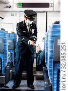 Купить «Japan, Honshu, Ticket Inspector on Japanese Railways (JR) Intercity Train Wearing Allergy Mask», фото № 32085251, снято 6 декабря 2019 г. (c) age Fotostock / Фотобанк Лори