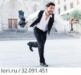 Купить «Emotional man in formalwear running», фото № 32091451, снято 5 августа 2017 г. (c) Яков Филимонов / Фотобанк Лори