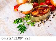 Купить «Stuffed squid in tomato sauce on background with greens, tomatoes», фото № 32091723, снято 21 января 2020 г. (c) Яков Филимонов / Фотобанк Лори