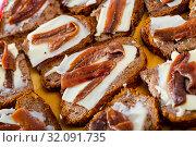 Купить «Bread with butter and salted anchovy fillets», фото № 32091735, снято 10 апреля 2020 г. (c) Яков Филимонов / Фотобанк Лори