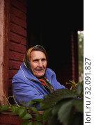 Купить «elderly woman on porch of country house», фото № 32091827, снято 21 сентября 2019 г. (c) Дарья Филимонова / Фотобанк Лори