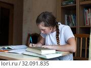 Купить «Cute schoolgirl at home.», фото № 32091835, снято 21 сентября 2019 г. (c) Дарья Филимонова / Фотобанк Лори