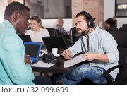 Купить «African and Latin entrepreneurs discussing project», фото № 32099699, снято 16 марта 2019 г. (c) Яков Филимонов / Фотобанк Лори