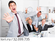 Купить «Excited businessman with happy team celebrating victory», фото № 32099735, снято 1 июля 2017 г. (c) Яков Филимонов / Фотобанк Лори