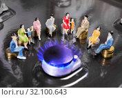 Купить «People doll sitting on coins around burning gas burners. Supply of natural gas to the population.», фото № 32100643, снято 29 августа 2019 г. (c) Элина Гаревская / Фотобанк Лори
